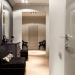 One bedroom apartment with Ralph Lauren wallpaper and designer furniture