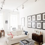 An apartment on Vasilyevsky Island with a sea themed interior, many pictures, and an English stove i...